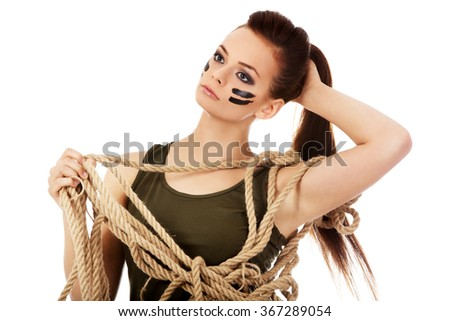 Young soldier woman holding a rope