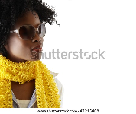 young South African woman with fashion sunglasses and yellow scarf