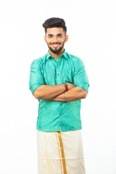 young South Indian man in traditional dress, dhoti and shirt