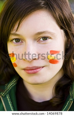 Young Spanish fan portrait staring at camera.