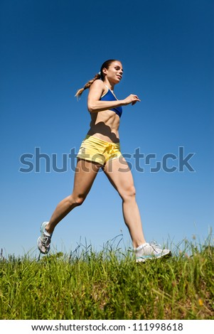 Young sport fitness woman running