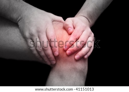 Young sport man having knee pain