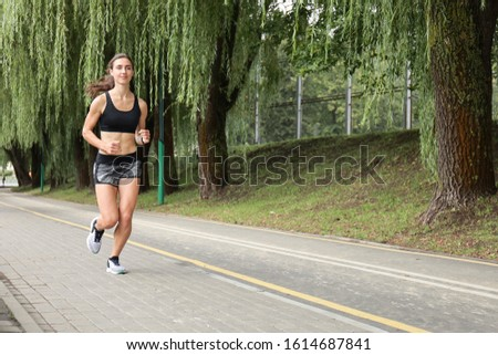 Young sport woman jogging in the park.