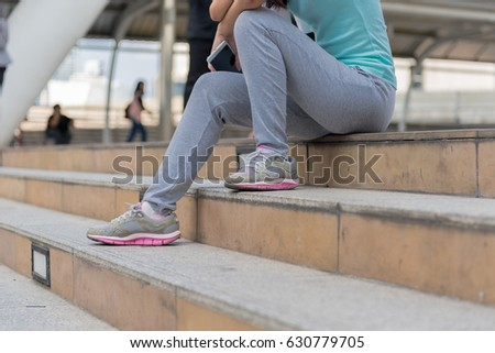 Young Sport woman resting after workout exercise.