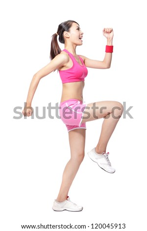 Young sport woman stretches her leg and arms and ready to sport in full length isolated on white background, model is a asian girl
