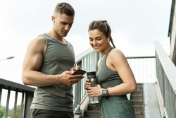 Young sportive couple relaxing after fitness workout outdoors