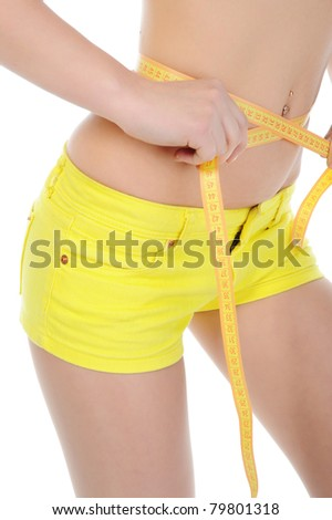 Young sports woman measuring waist. Isolated on white background
