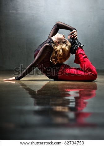 Young sports woman stretching on floor.