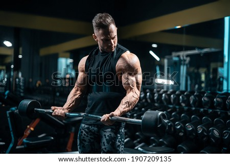 young sportsman bodybuilder have workout and exercising with barbell in gym Photo stock ©