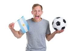 Young sporty man with Argentina flag and soccer ball, isolated on white background.