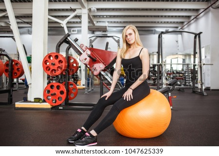 young sporty slender woman in...