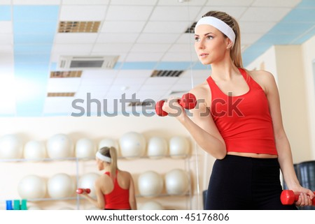 Young sporty woman in the gym centre. - stock photo