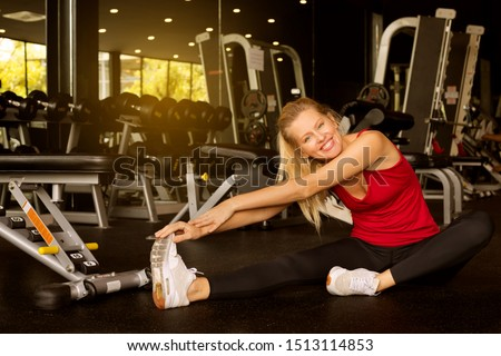 Young sporty woman stretching at gym.Fit Caucasian woman stretching her leg to warm up.sexy women stretch before exercising.Concept of exercise in gym. Happy sweetest day images
