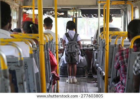 Young sri lankan girl going to school by bus