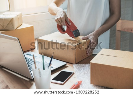 Young startup small business entrepreneur woman working with smart phone at home, Online business and delivery concept