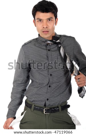 Young stressed bankrupt stressed Asian,  Nepalese businessman with trousers pockets showing,  white background,  studio shot.
