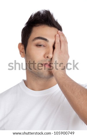 Young stressed man with hand on his face isolated on white background.