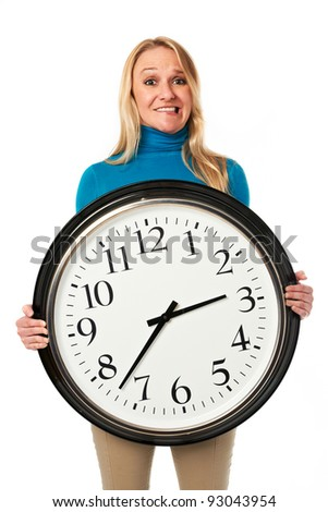 Young stressed woman holding a big clock