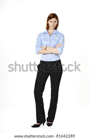 Young strict businesswoman isolated on a white background standing in a defensive position