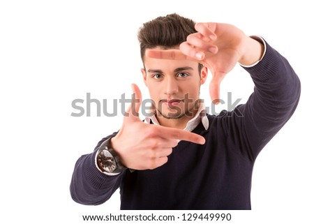 Young student boy making framing key gesture - isolated over white