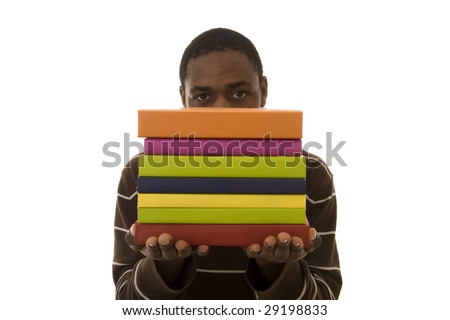 young student carrying a lot of colorful school books