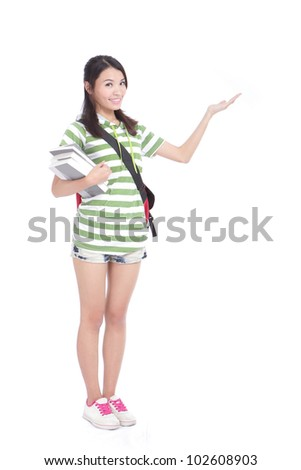 young student girl happy smiling and hand showing on open palm with empty copy space in full length , isolated over white background, model is a asian beauty