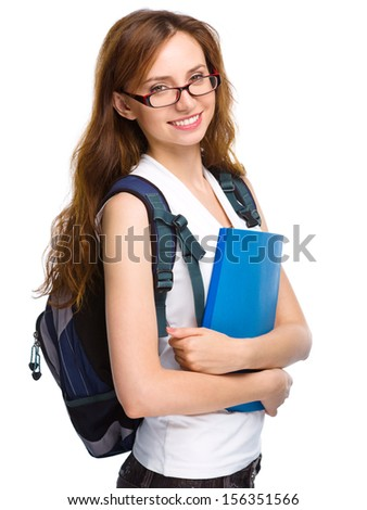 Young student girl is holding exercise book, isolated over white