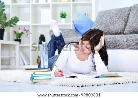 Young student girl with books on floor studying