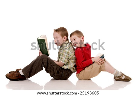 young student looking over his scolder into another kids book