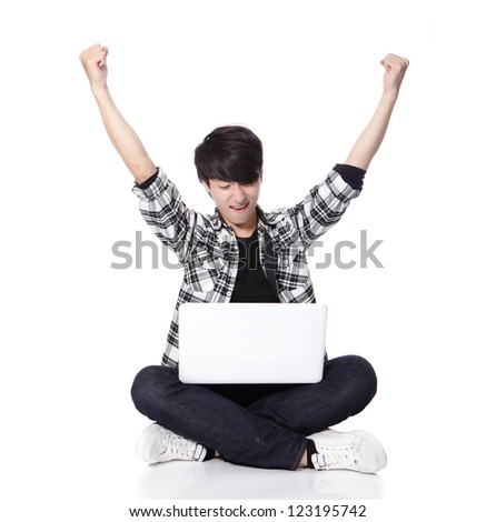 Young student Man with laptop and sitting on floor and excited raise his arms in full length isolated on white background, asian model