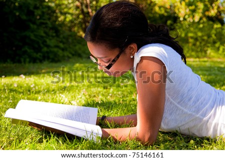 Young Student reading books at  school park