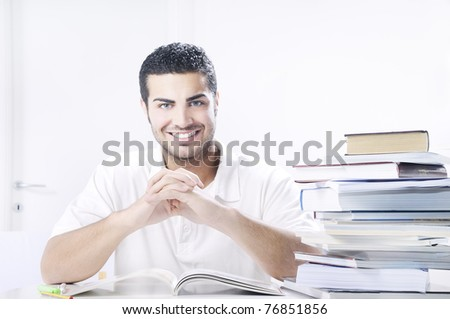young student smiling with books on white background, concept of successful