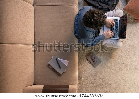 Young student watching lesson online and studying from home. Concept of studying at home.
