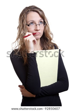 Young student with a pen and notebook thinking