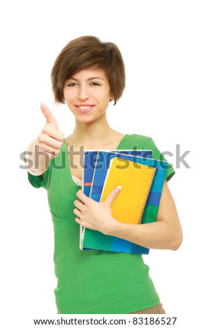 Young student with her books in hand giving thumb-up gesture, isolated on white background