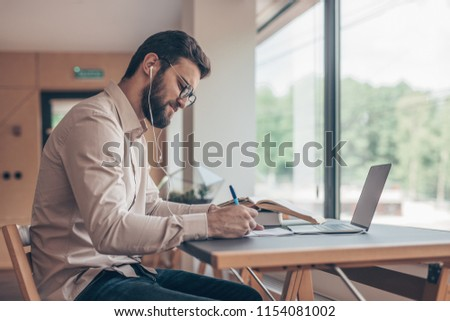 Young student with laptop indoors