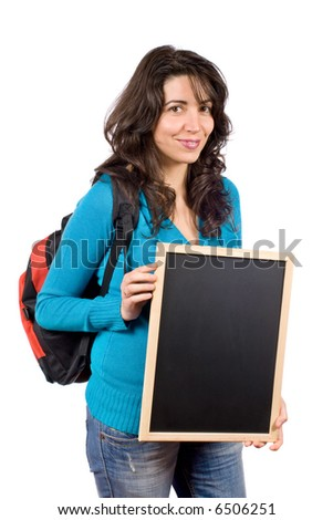 Young student woman with a backpack and holding the chalkboard on white background