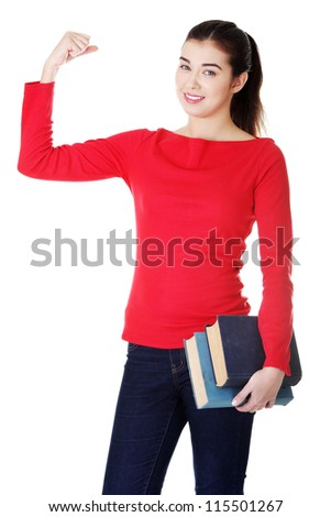 Young student woman with books showing her biceps, isolated on white