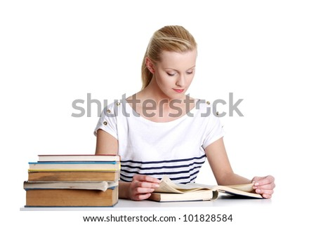 Young student woman with lots of books studying for exams.