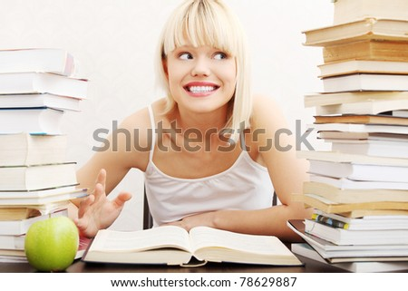 Young student woman with lots of books studying for exams. isolated on white background