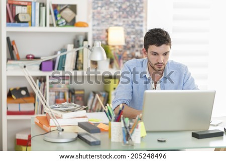 young student works on his laptop at home stock photo