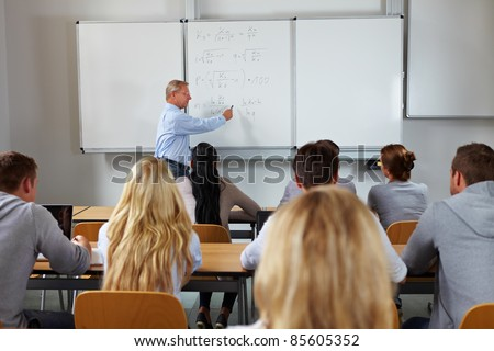 Young students in class at economic studies at university - stock photo