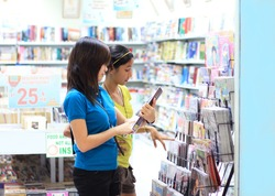 young students shopping for books and magazines