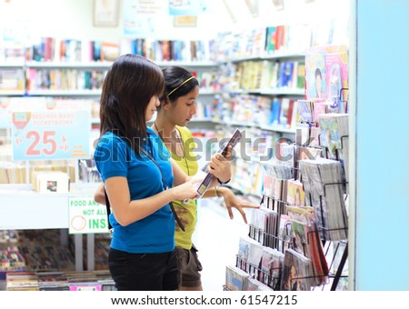 young students shopping for books and magazines Stockfoto ©