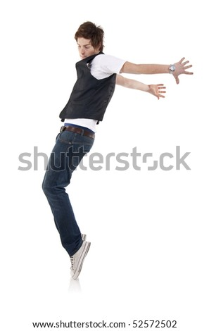 Young stylish  dancer in front of white background moving to hip hop music.