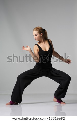 young stylish female dancing modern ballet dance - stock photo