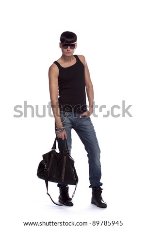 Young stylish guy in sunglasses. Male fashion model