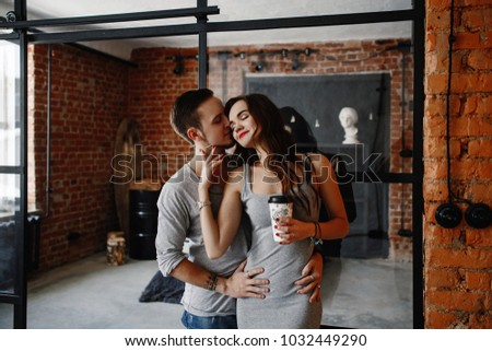 Young stylish hipsters couple. guy and girl in love hugging together. Indoors. Portrait. interior in style the loft. lifestyle moments at home  #1032449290