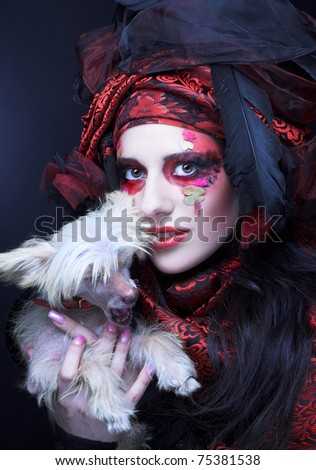 Young stylish lady in exotic image with little dog