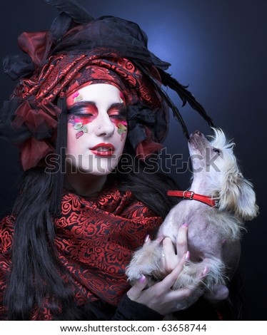 Young stylish lady in exotic image witn little dog